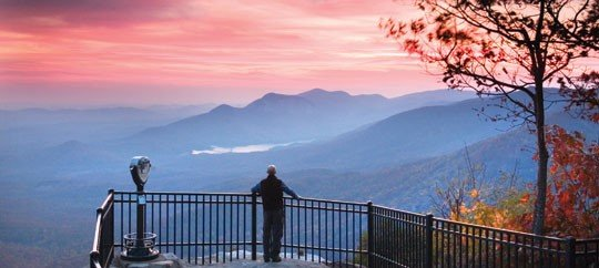 man looking out over Ceasar's Head mountain in Greenville South Carolina