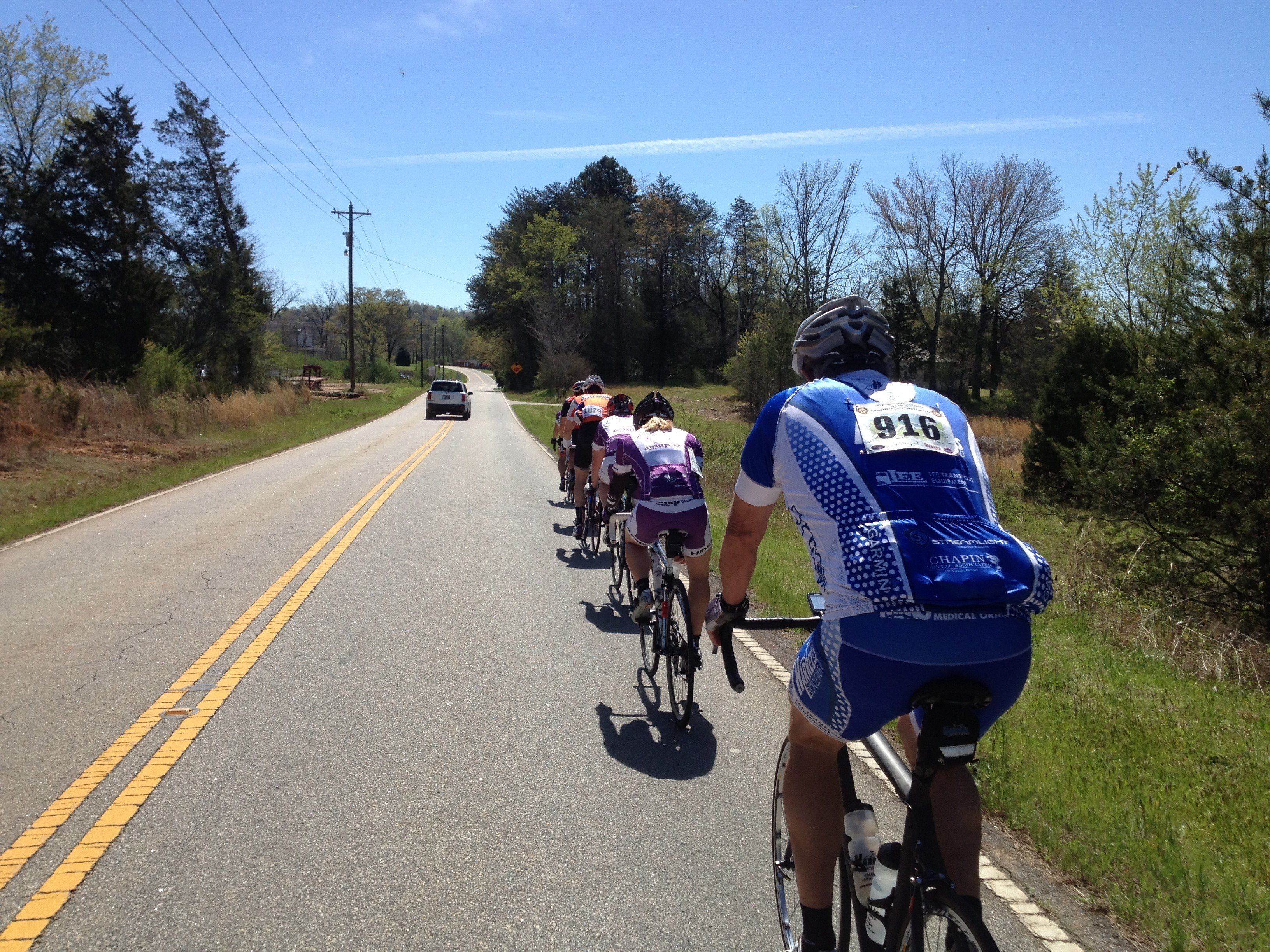 Cyclists riding on road at cycling camp