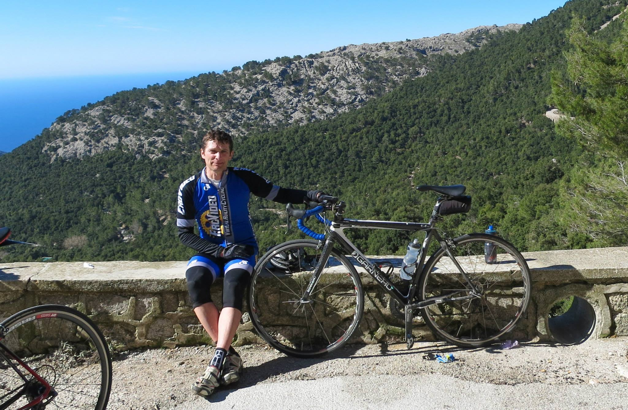 Cycling coach Paul Smeulders sits on wall in Mallorca Spain