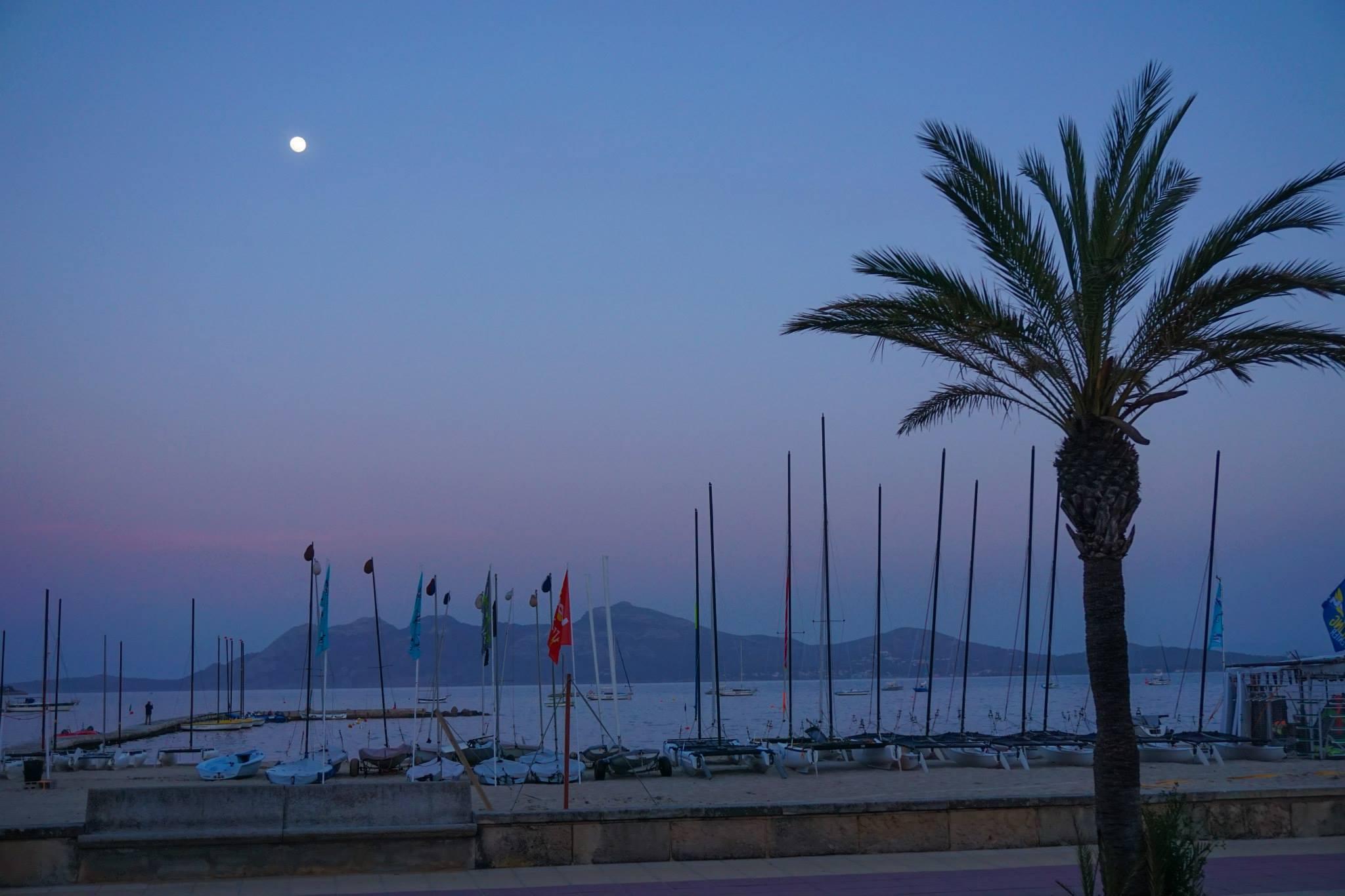 Pollensa Bay moon seen at cycling camp in Mallorca Spain