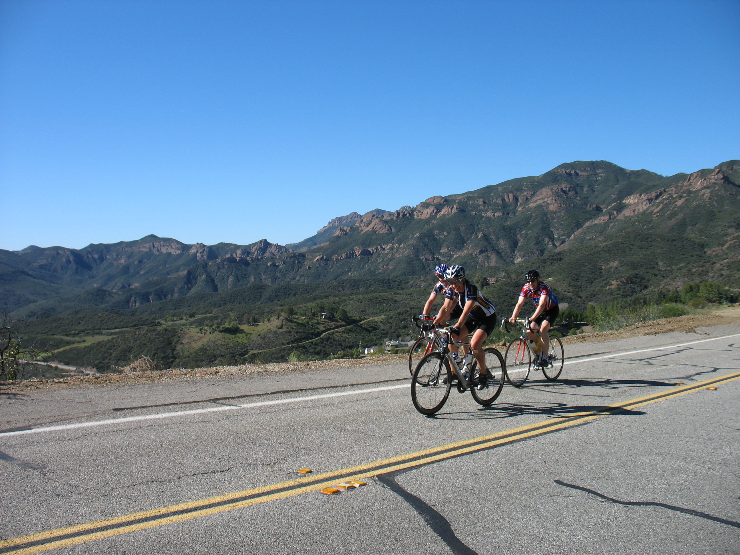 Cyclists climbing Latigo Canyon in California at cycling camp