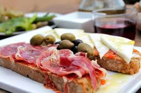 Olives cheese pam boli lunch at cafe at cycling camp in Spain