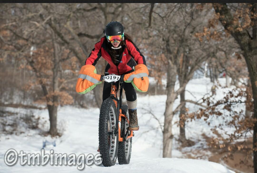 cyclist Rhonda Wright rides bike in snow race