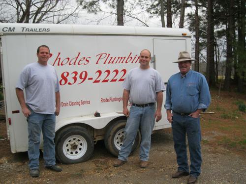 Rhodes plumbing van and staff