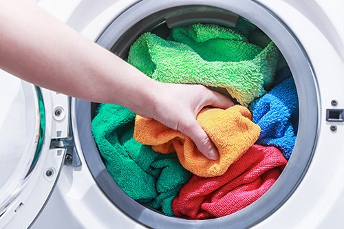 Coloured clothes put in the washing machine for cleaning
