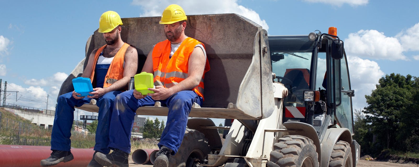 two construction workers eating lunch
