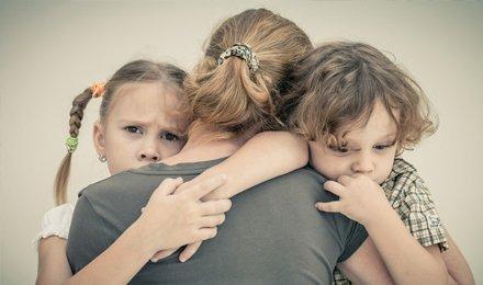 children hugging their mom