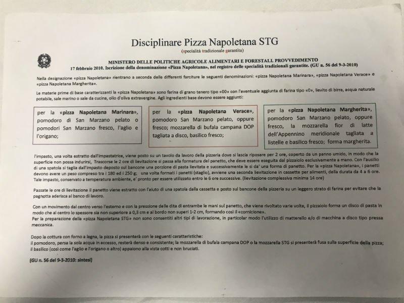 una foglio con scritto Disciplinare Pizza Napoletana STG