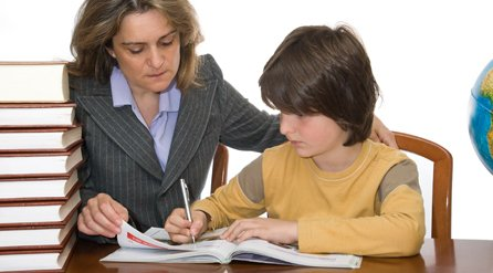 lady helping boy with his homework