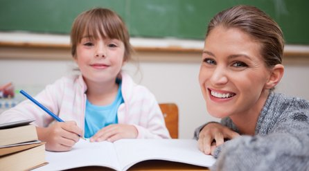 Teacher helping the student