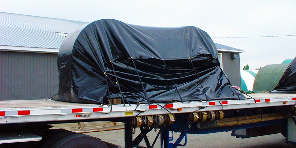 Cover-Tech Inc. flatbed tarps Custom coil tarps with a grommet row