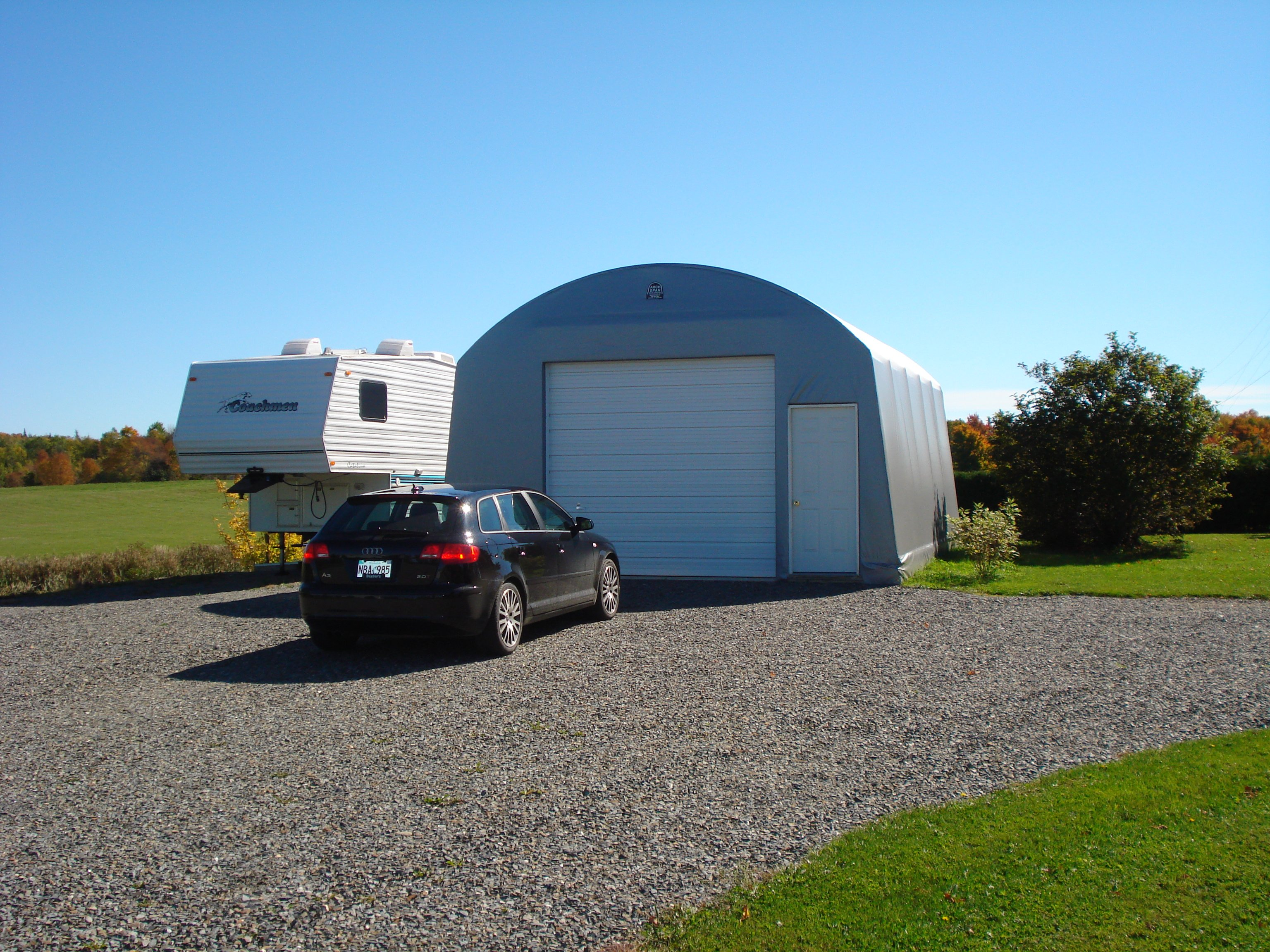 TWO CAR GARAGES cover-tech inc. call toll free 1-888-325-5757