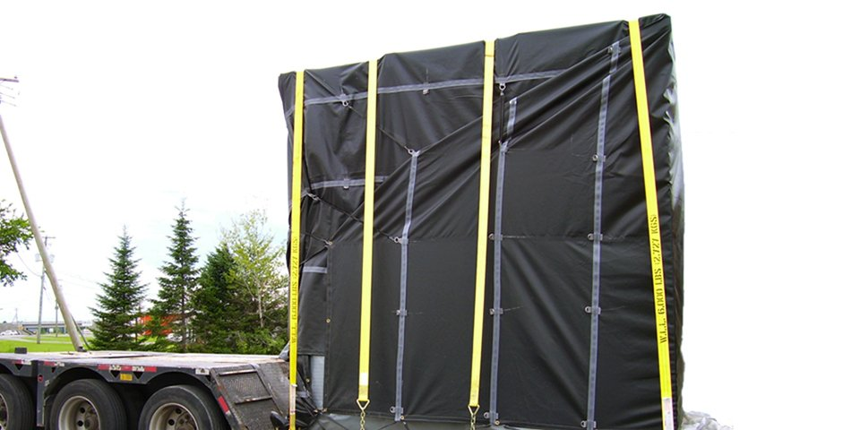 Cover-Tech Inc. Flatbed Tarps Custom made truck tarp covering crated machinery