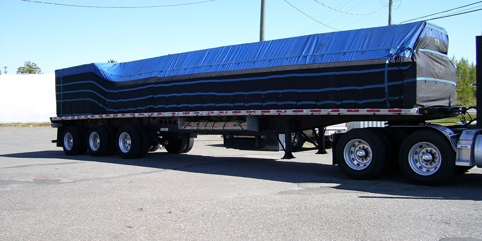 Cover-Tech Inc. Flatbed Tarps Truck tarp shown above with an 18 oz vinyl top and super lightweight sides