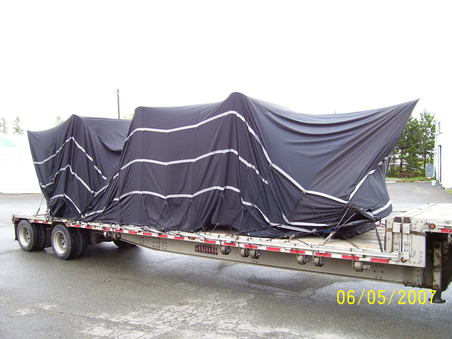 Cover-Tech Inc. flatbed tarps Super lightweight ballistic truck tarps covering airplane propellers