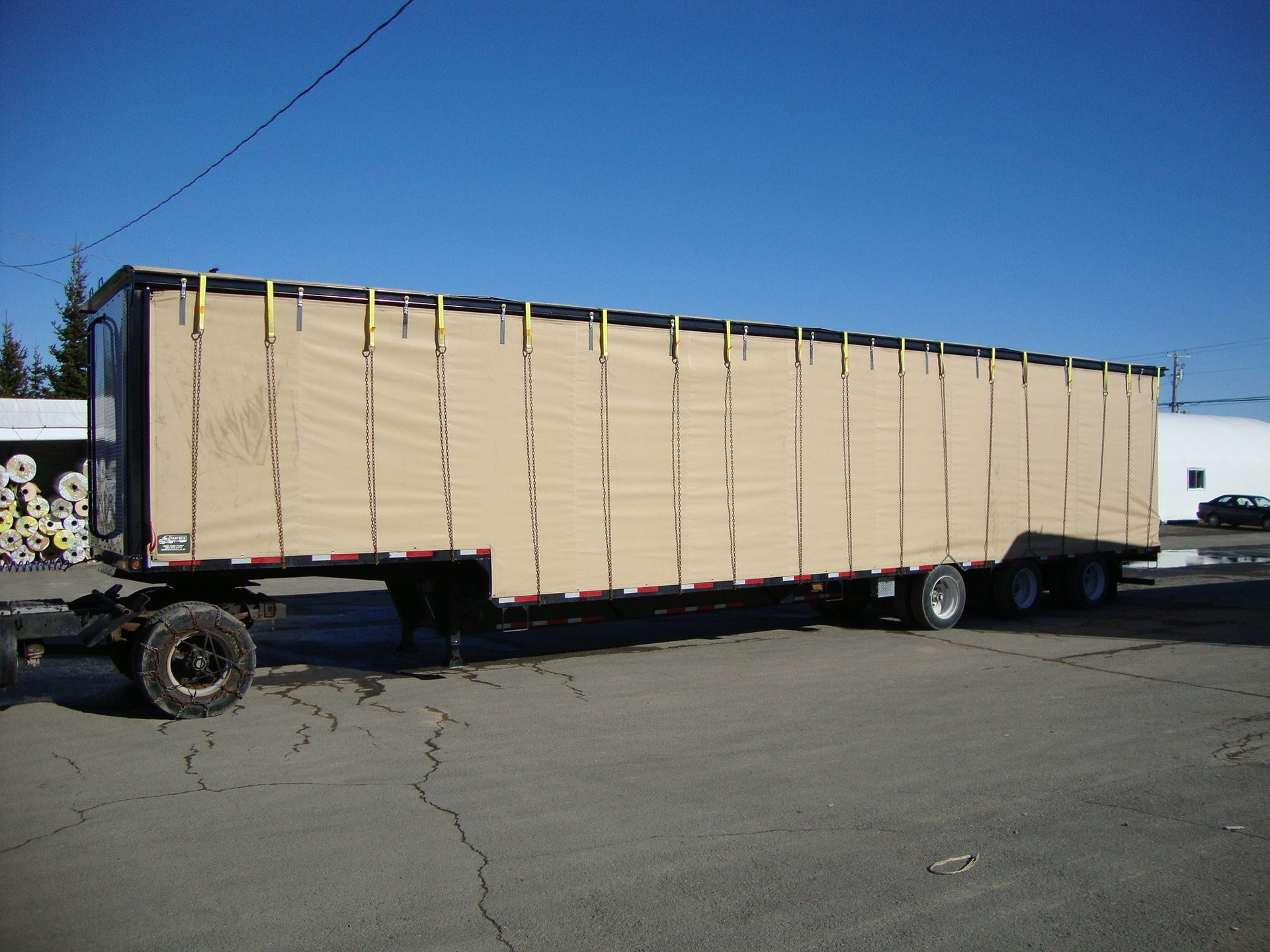 Cover-Tech Inc. flatbed tarps Rolling side curtains on a chicken trailer