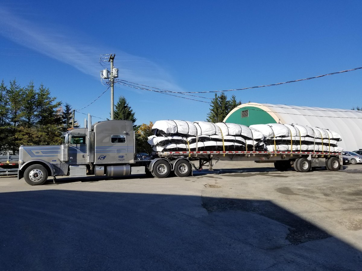 Cover-Tech Inc. custom made  insulated tarps being used to cure concrete for Muskrat Falls.