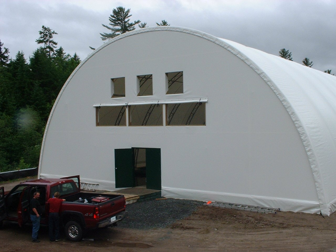 DOME BUILDINGS fabric buildings 55' x 150' covering salmon tanks