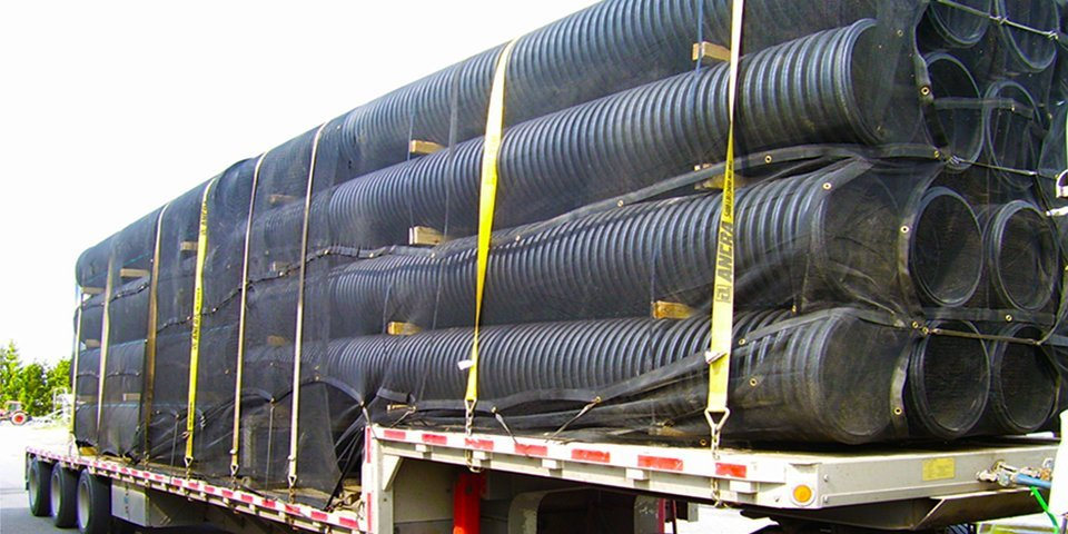 Cover-Tech Inc. flatbed tarps Custom mesh tarps complete with grommet rows.