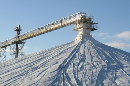 Large 300' diameter stockpile cover connected to a conveyor