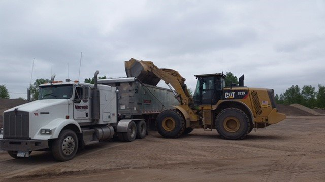 Yellow bulldozer with contract professional in Victor
