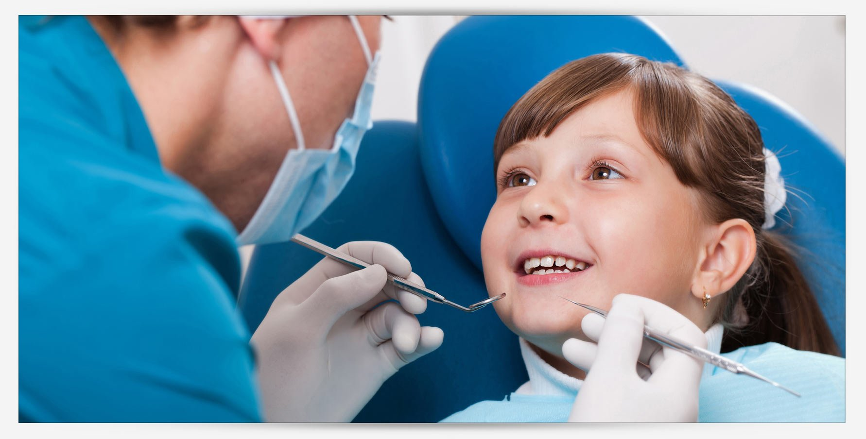 blue apple dental child smiling at the dentist
