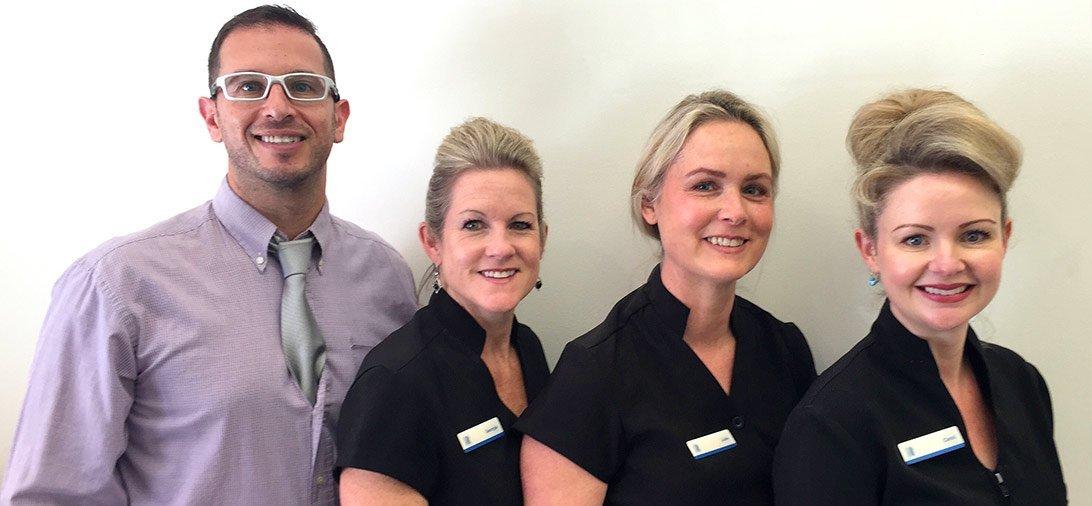 blue apple dental team photo