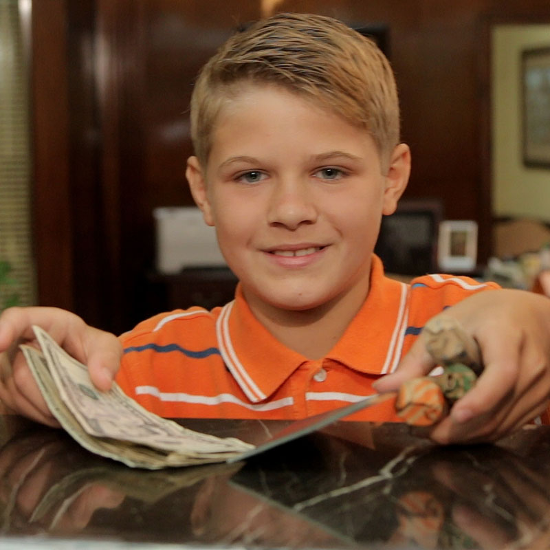 A kid depositing money into his savings account in Mebane, north Carolina