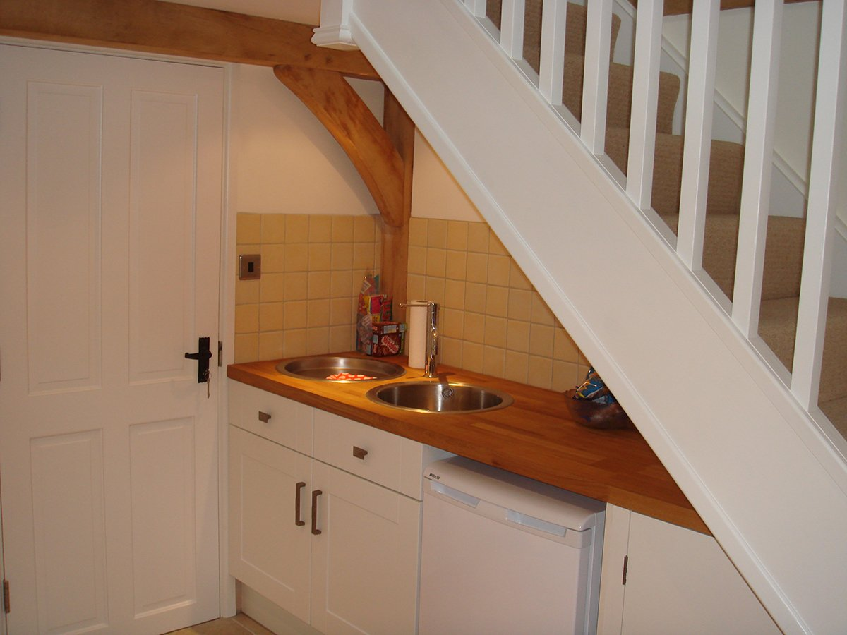 fitted kitchen under the stairs