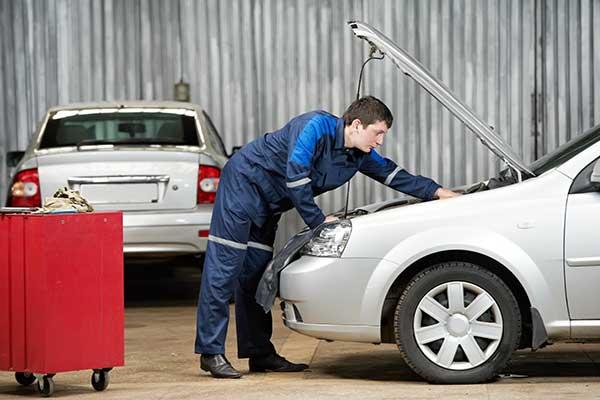 Mechanic diagnosing automobile car engine