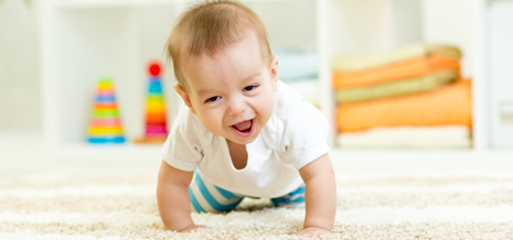 Baby crawling on a clean carpet in Columbia, MO