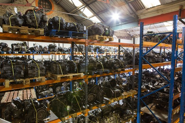 Shelves of used engines and gearboxes