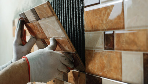 Professional fixing tiles on the kitchen wall in West Chester, OH