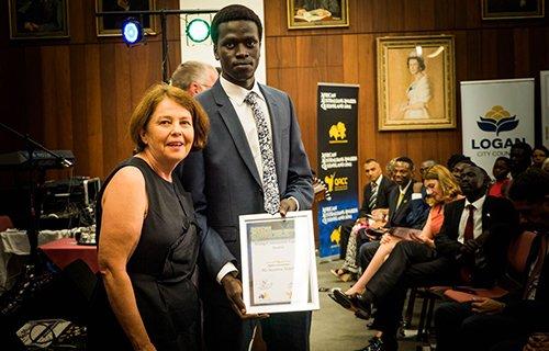 African-Australian winner being handed the certificate