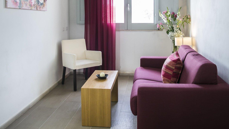 angolo relax con divano a poltrona