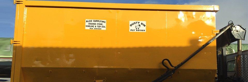A large yellow Dusty Bin skip wagon