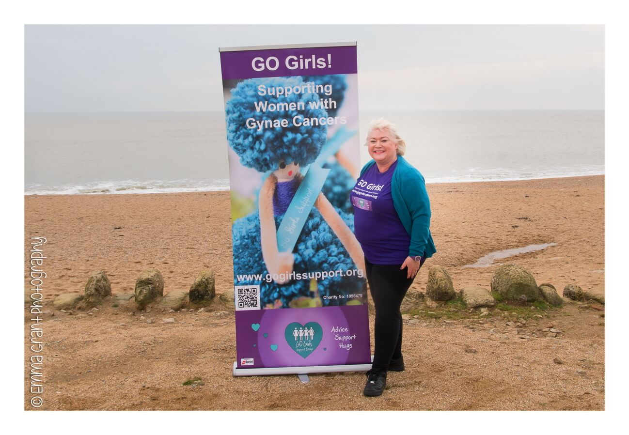go girl member and banner at the beach