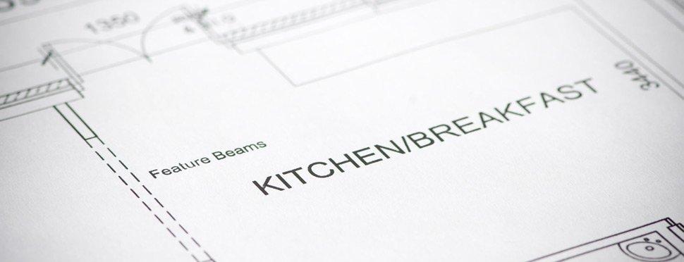 a paper plan of a kitchen