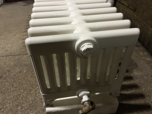 Radiator shot blasted, primed and top coated