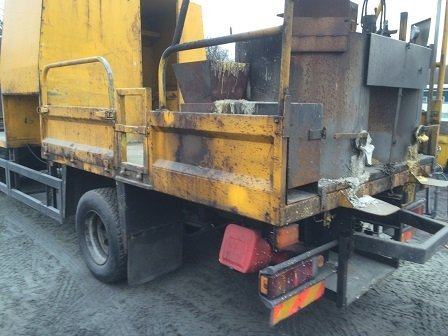 Works lorry in need of surface repair