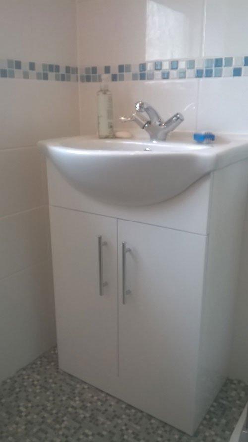 sink and a bathroom cupboard
