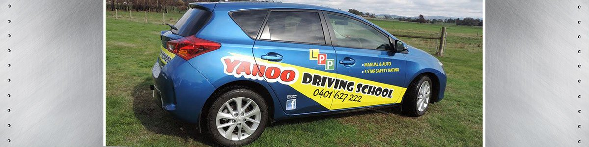 yahoo driving school name painted on car