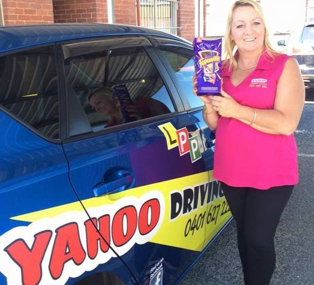 yahoo driving school woman with box standing near the car
