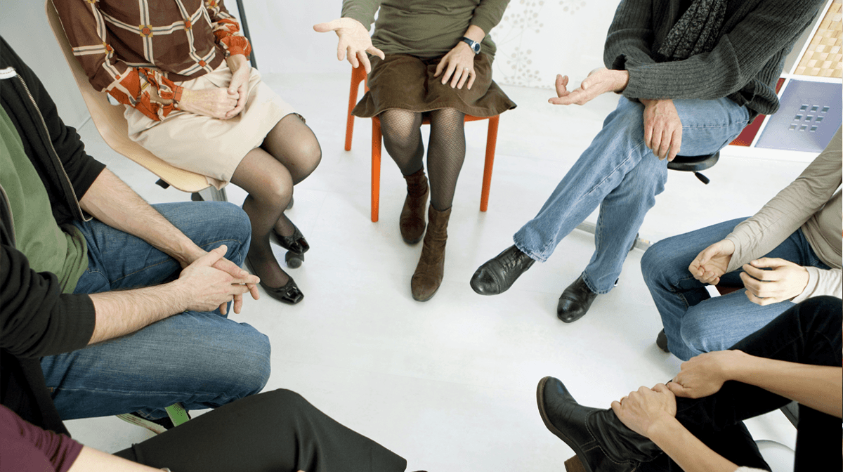 Women embracing at support group