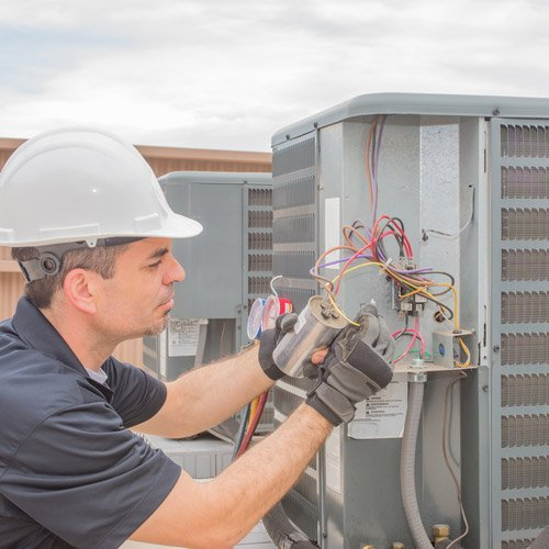 Man servicing commercial AC units