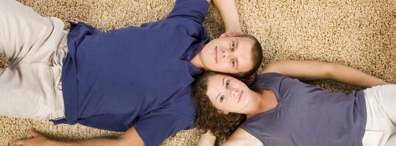 Couple enjoying their carpet flooring in Gore