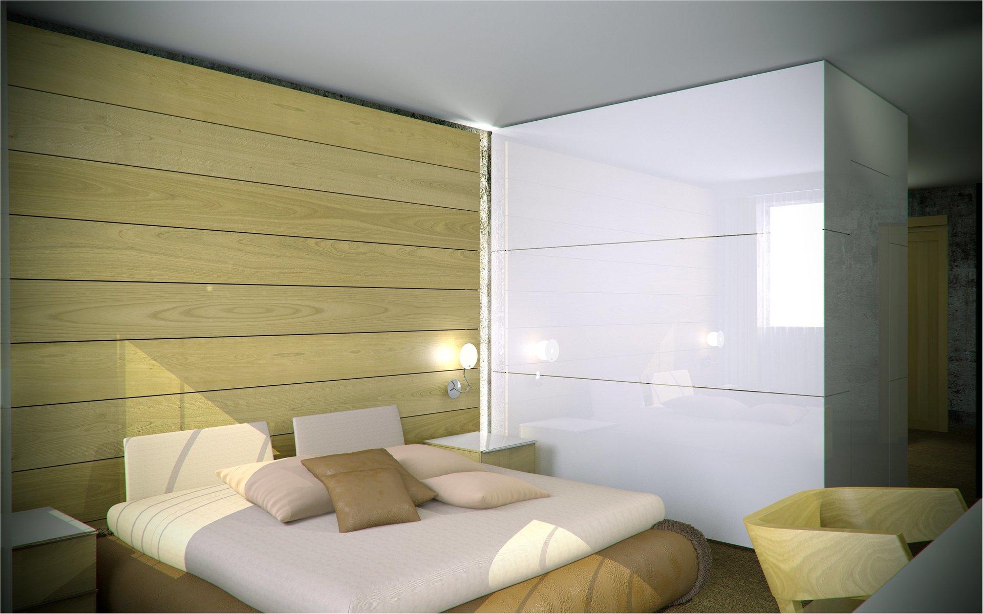 vista angolare di una camera da letto color verde chiaro