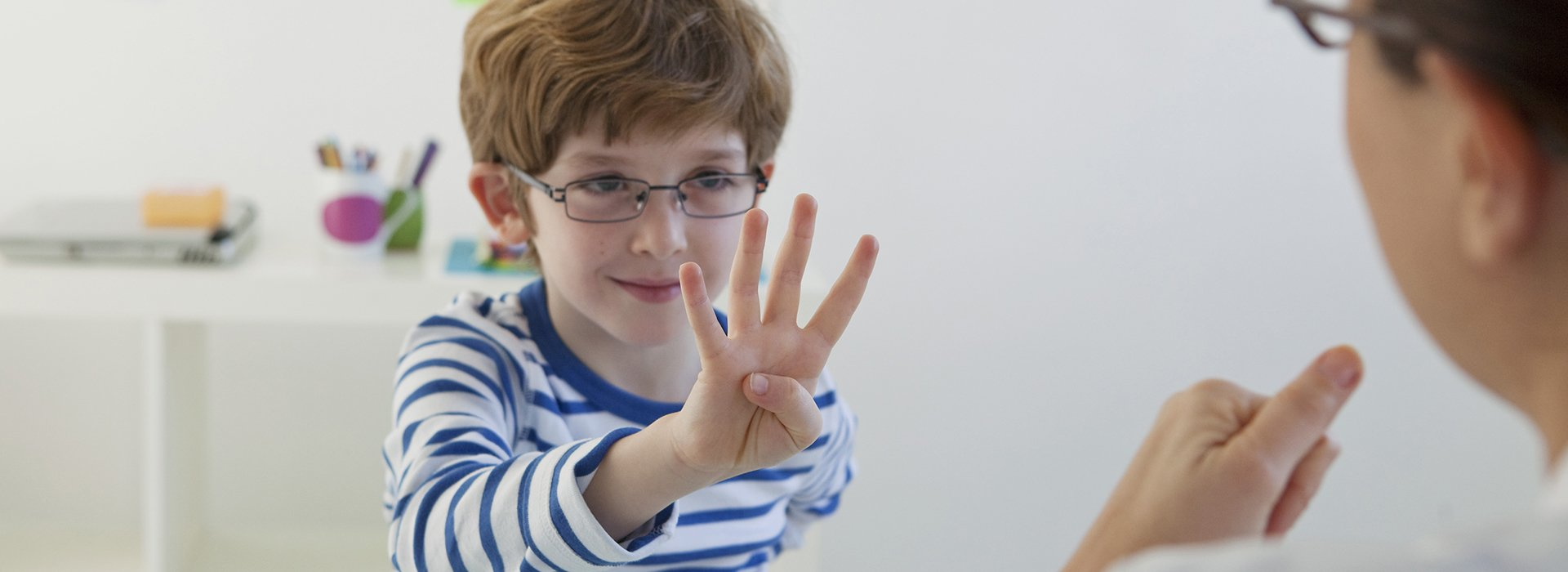 Boy learning to count