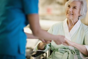 Old woman hold hands of a nurse