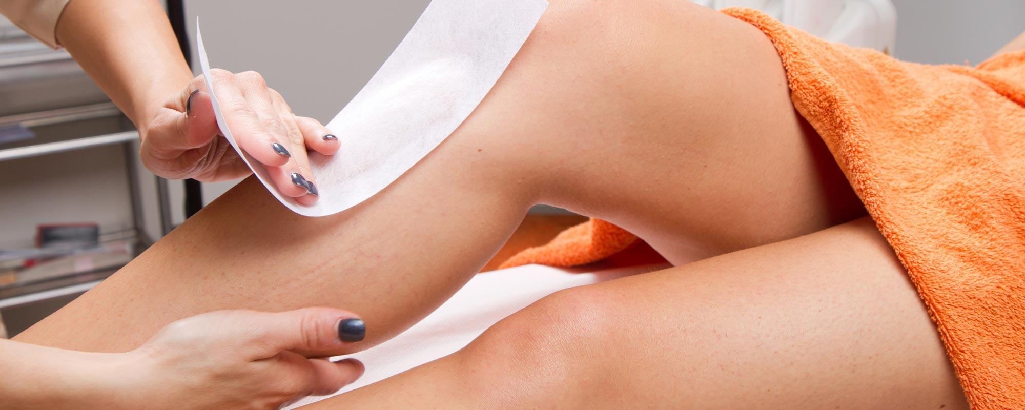 Women getting her leg waxed